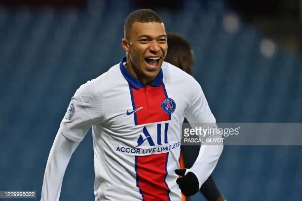 Paris Saint-Germain's French forward Kylian Mbappe celebrates after scoring a goal during the French L1 football match between Montpellier Herault...