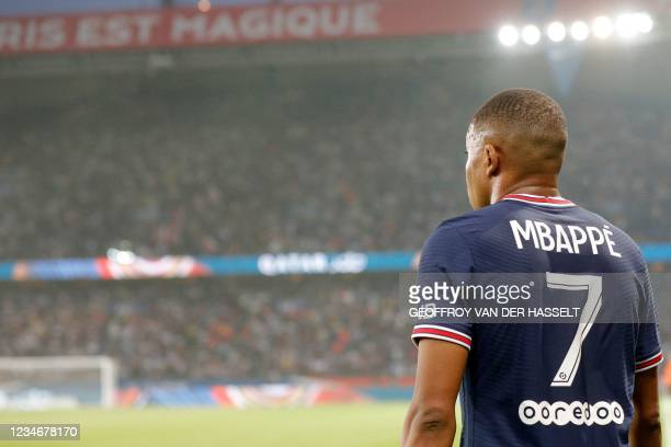 Paris Saint-Germain's French forward Kylian Mbappe celebrates after scoring a goal during the French L1 football match between Paris Saint-Germain...