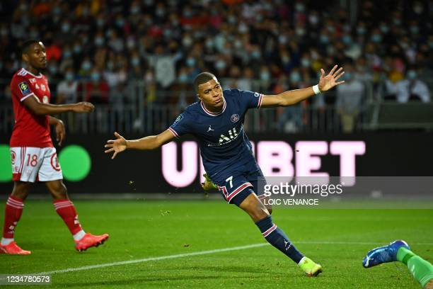 Paris Saint-Germain's French forward Kylian Mbappe celebrates after scoring a goal during the French L1 football match between Stade Brestois and...