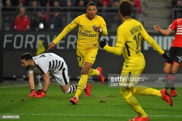 Paris SaintGermain's French forward Kylian Mbappe celebrates after scoring a goal during the French L1 football match between Rennes and Paris Saint...