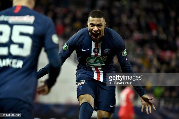 Paris Saint-Germain's French forward Kylian Mbappe celebrates after an own goal by a Dijon player during the French Cup quarter final football match...