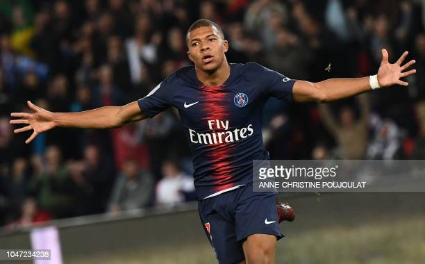 Paris SaintGermain's French forward Kylian Mbappe celebrates after he scored a goal during the French L1 football match between Paris SaintGermain...
