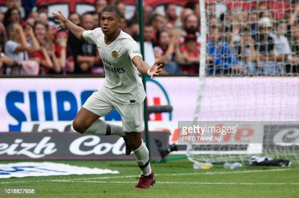 TOPSHOT Paris SaintGermain's French forward Kylian Mbappe celebrates after scoring their second goal during the French L1 football match between...