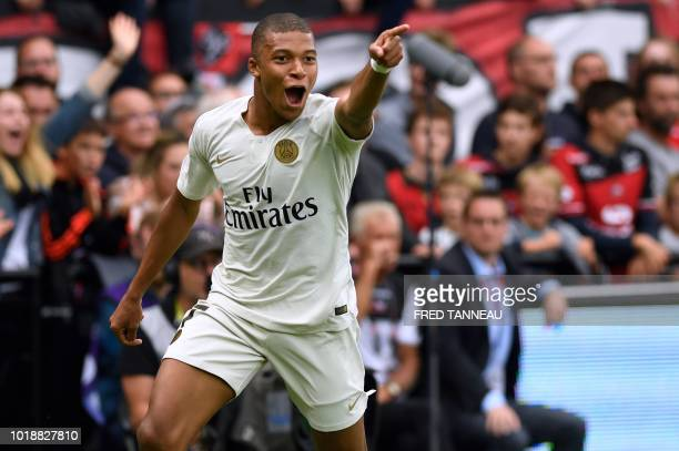 TOPSHOT Paris SaintGermain's French forward Kylian Mbappe celebrates after scoring their third goal during the French L1 football match between...