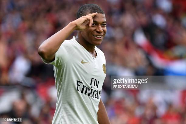Paris SaintGermain's French forward Kylian Mbappe celebrates after scoring during the French L1 football match between Guingamp and Paris...