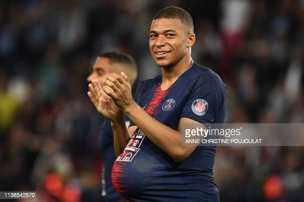 Paris Saint-Germain's French forward Kylian Mbappe celebrates after winning the French L1 football match between Paris Saint-Germain and Monaco on...