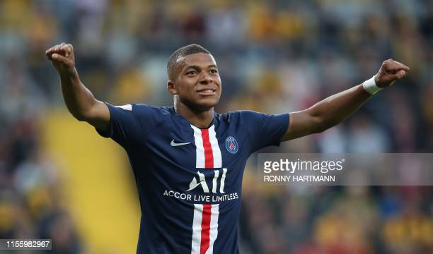 Paris Saint-Germain's French forward Kylian Mbappe celebrates after scoring the 3-0 goal during the pre-season friendly football match Dynamo Dresden...
