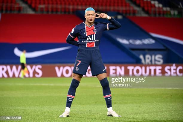 Paris Saint-Germain's French forward Kylian Mbappe celebrates after scoring during the French L1 football match between Paris-Saint Germain and FC...