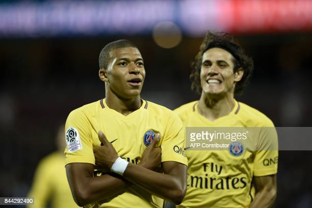 Paris SaintGermain's French forward Kylian Mbappe celebrates after scoring during the French L1 football match between Metz and Paris SaintGermain on...