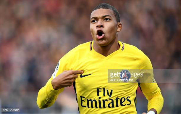 Paris SaintGermain's French forward Kylian Mbappe celebrates after scoring the opening goal during the French L1 football match between Angers and...