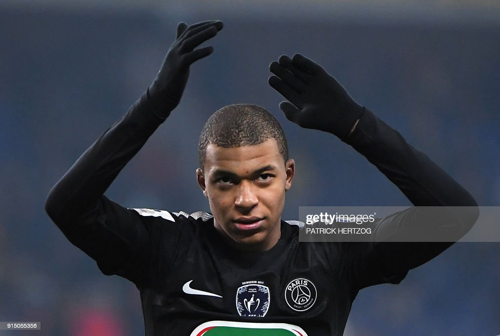 Paris Saint-Germain's French forward Kylian Mbappe celebrates at the end of the French Cup football match between Sochaux (FCSM) and Paris Saint-Germain (PSG) on February 6, 2018 at the Auguste Bonal Stadium in Montbeliard, eastern France. /