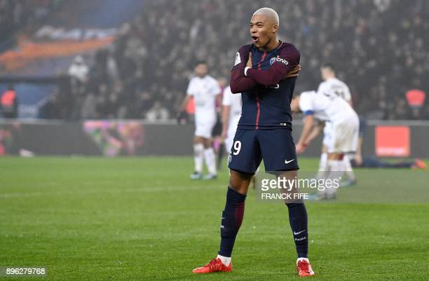 Paris SaintGermain's French forward Kylian MBappe celebrates his goal during the French L1 football match between Paris SaintGermain and Caen at the...