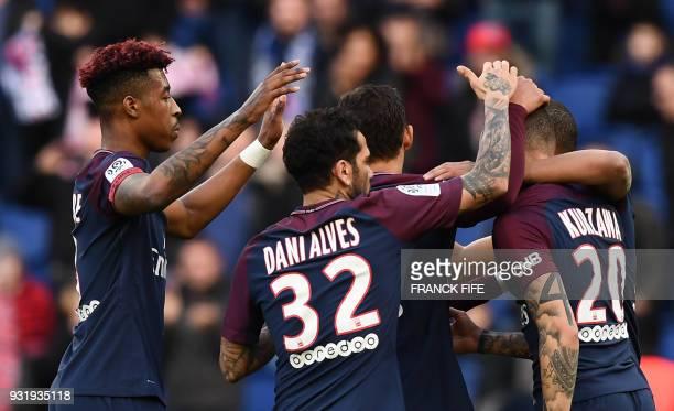 Paris SaintGermain's French forward Kylian MBappe celebrates his goal with Paris SaintGermain's French defender Presnel Kimpembe Paris SaintGermain's...