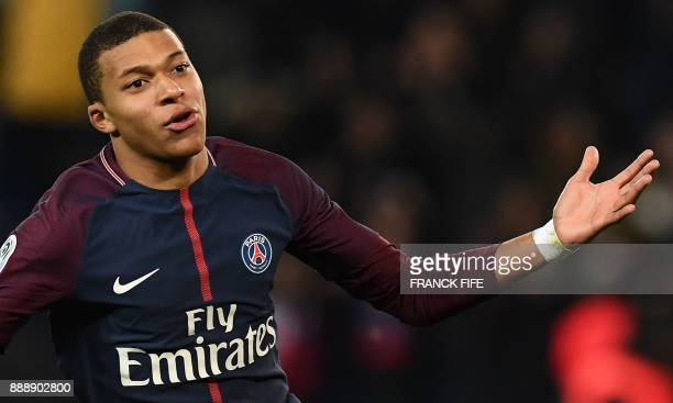 Paris SaintGermain's French forward Kylian MBappe celebrates his last second goal during the French L1 football match between Paris SaintGermain and...