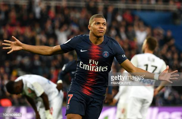 TOPSHOT Paris SaintGermain's French forward Kylian Mbappe celebrates scoring his team's fourth goal during the French L1 football match between Paris...