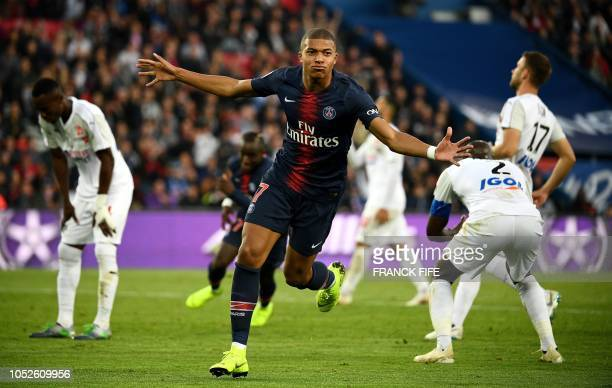 Paris SaintGermain's French forward Kylian Mbappe celebrates scoring his team's fourth goal during the French L1 football match between Paris...