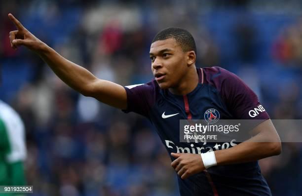 Paris SaintGermain's French forward Kylian MBappe celebrates scoring the opening goal during the French L1 football match between Paris SaintGermain...