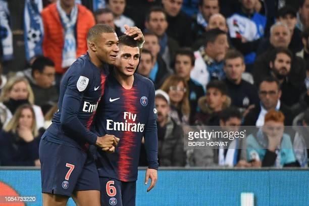 Paris SaintGermain's French forward Kylian Mbappe celebrates with teammate Paris SaintGermain's Italian midfielder Marco Verratti after scoring a...
