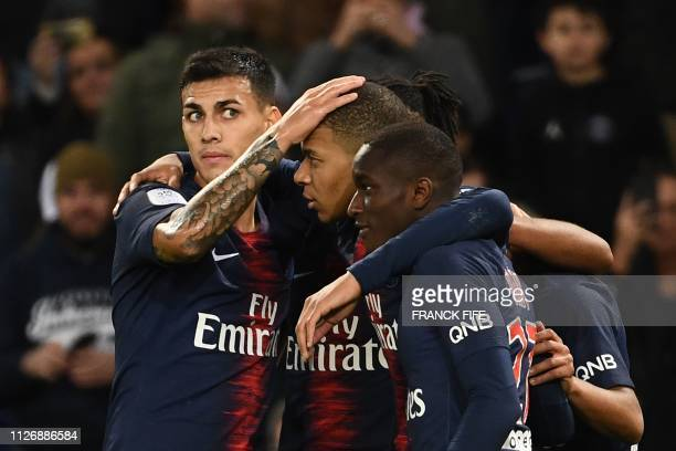Paris SaintGermain's French forward Kylian Mbappe celebrates with teammates after scoring his team's third goal during the French L1 football match...