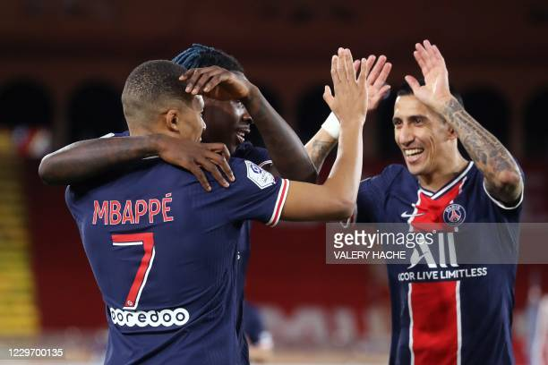 Paris Saint-Germain's French forward Kylian Mbappe celebrates with Paris Saint-Germain's Italian forward Moise Kean and Paris Saint-Germain's...