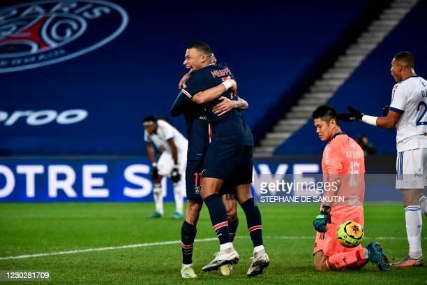 Paris Saint-Germain's French forward Kylian Mbappe celebrates with Paris Saint-Germain's Argentine midfielder Angel Di Maria after scoring a goal...