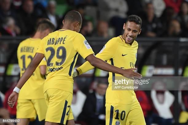 Paris SaintGermain's French forward Kylian Mbappe celebrates with Paris SaintGermain's Brazilian forward Neymar following a goal during the French L1...