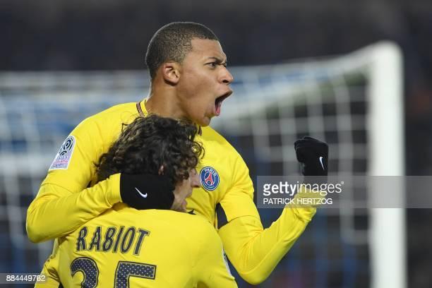 Paris SaintGermain's French forward Kylian Mbappe celebrates with Paris SaintGermain's French midfielder Adrien Rabiot after scoring a goal during...