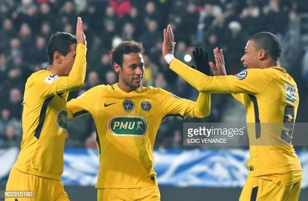 Paris SaintGermain's French forward Kylian Mbappe celebrates with Argentinian forward Angel Di Maria and Brazilian forward Neymar after scoring...