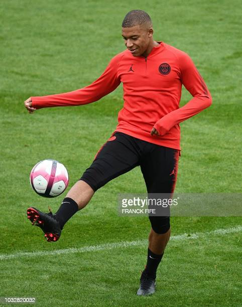 Paris SaintGermain's French forward Kylian Mbappe controls the ball during a training session at SaintGermainenLaye western Paris on September 13...