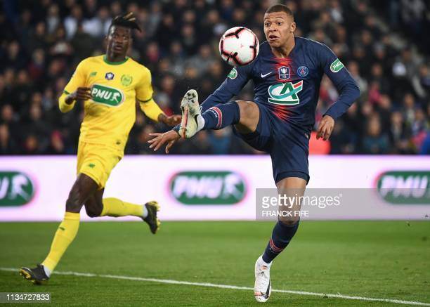 Paris SaintGermain's French forward Kylian Mbappe controls the ball during the French Cup semifinal football match between Paris SaintGermain and FC...