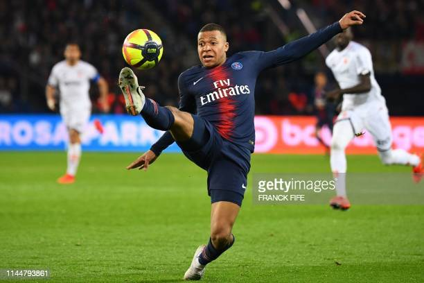 TOPSHOT Paris SaintGermain's French forward Kylian Mbappe controls the ball during the French L1 football match between Paris SaintGermain and Dijon...