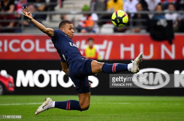 Paris SaintGermain's French forward Kylian MBappe controls the ball during the French L1 football match between Reims and Paris SaintGermain at the...