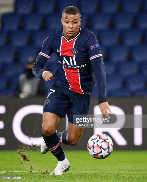 Paris SaintGermain's French forward Kylian Mbappe controls the ball during the UEFA Champions League Group H firstleg football match between Paris...