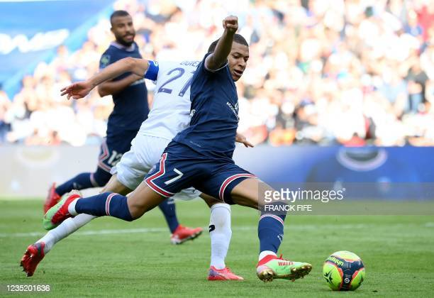 Paris Saint-Germain's French forward Kylian Mbappe controls the ball during the French L1 football match between Paris-Saint Germain and Clermont...