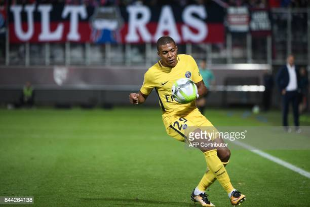 Paris SaintGermain's French forward Kylian Mbappe controls the ball during the French L1 football match between Metz and Paris SaintGermain on...