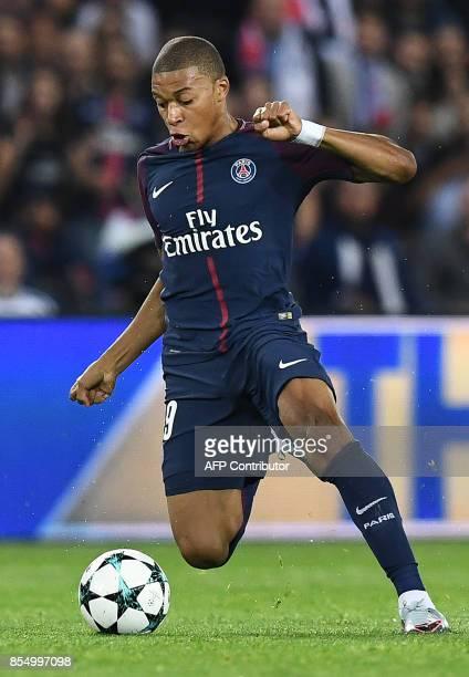 Paris SaintGermain's French forward Kylian Mbappe controls the ball during the UEFA Champions League football match between Paris SaintGermain and...