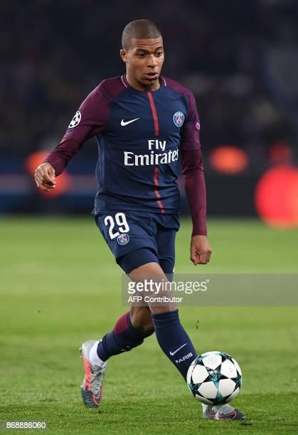 Paris SaintGermain's French forward Kylian Mbappe controls the ball during the UEFA Champions League Group B football match between Paris...