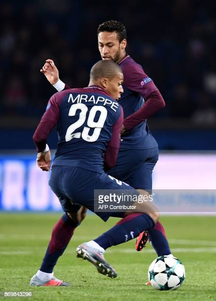 Paris SaintGermain's French forward Kylian Mbappe controls the ball next to Paris SaintGermain's Brazilian forward Neymar during the UEFA Champions...