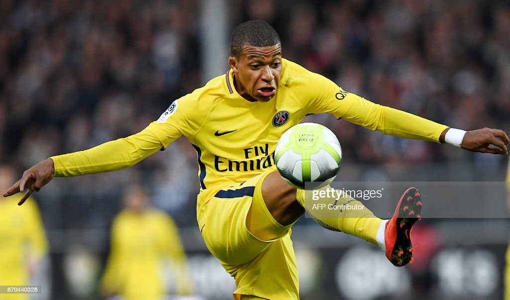 Paris Saint-Germain's French forward Kylian MBappe controls the ball during the French Ligue 1 football match between Angers (SCO) and Paris Saint-Germain (PSG) at The Raymond-Kopa Stadium in Angers on November 4, 2017. /