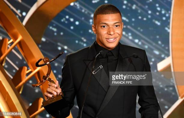 TOPSHOT Paris SaintGermain's French forward Kylian Mbappe delivers a speech after receiving the best hope player award on May 19 2019 in Paris during...