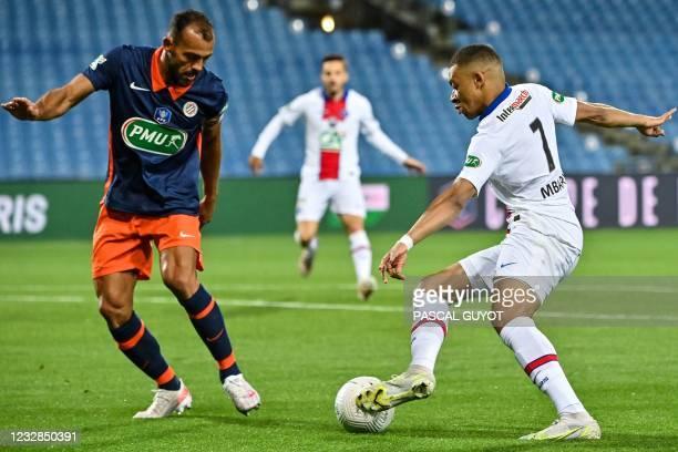Paris Saint-Germain's French forward Kylian Mbappe dribbles Montpellier's Brazilian defender Vitorino Hilton before scoring a goal during the French...