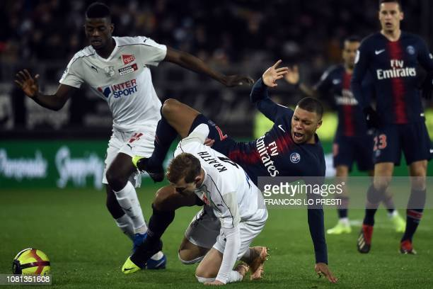 Paris SaintGermain's French forward Kylian Mbappe fights for the ball with Amien's Swedish defender Emil Krafth during the French L1 football match...