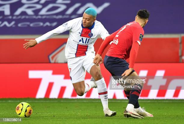 Paris Saint-Germain's French forward Kylian Mbappe fights for the ball with Lille's Turkish defender Zeki Celik during the French L1 football match...