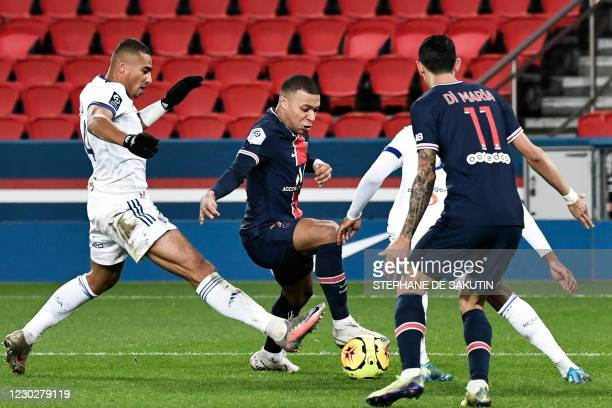 Paris Saint-Germain's French forward Kylian Mbappe fights for the ball with Strasbourg's French defender Alexander Djiku during the French L1...