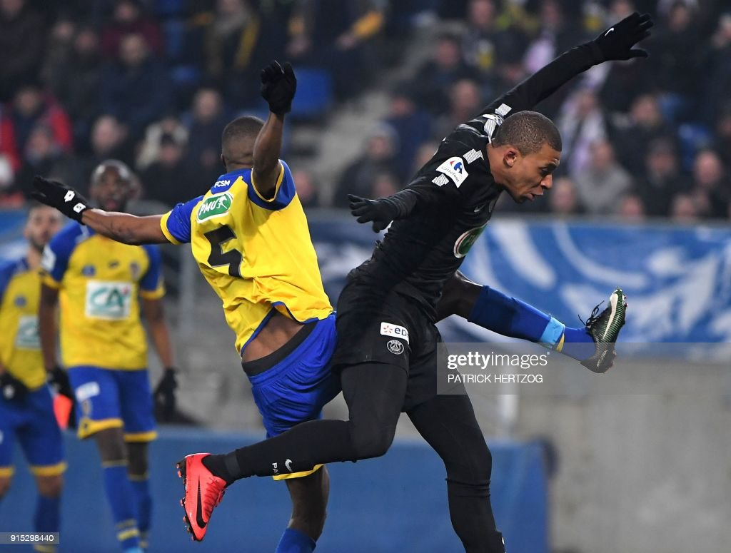 Paris Saint-Germain's French forward Kylian Mbappe (R) fights for the ball with Sochaux' French defender Zakarya Bergdich during the French Cup football match between Sochaux (FCSM) and Paris Saint-Germain (PSG) at the Auguste Bonal Stadium in Montbeliard, eastern France on February 6, 2018. /