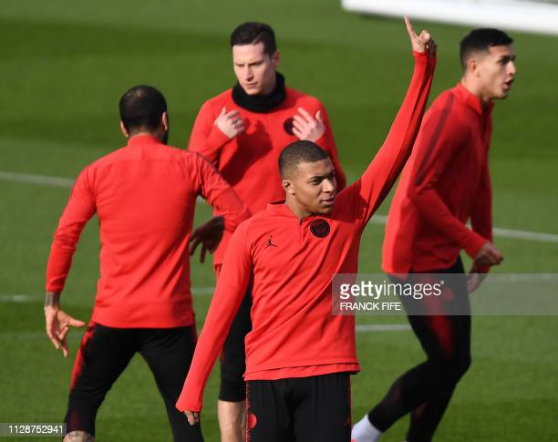Paris SaintGermain's French forward Kylian Mbappe gestures during a training session at the club's Camp des Loges training grounds in...