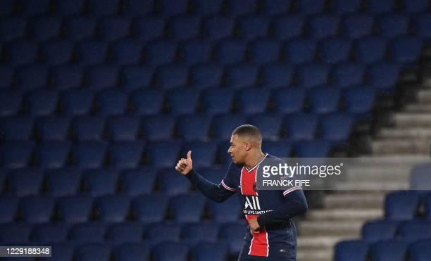 Paris SaintGermain's French forward Kylian Mbappe gestures during the UEFA Champions League Group H firstleg football match between Paris...
