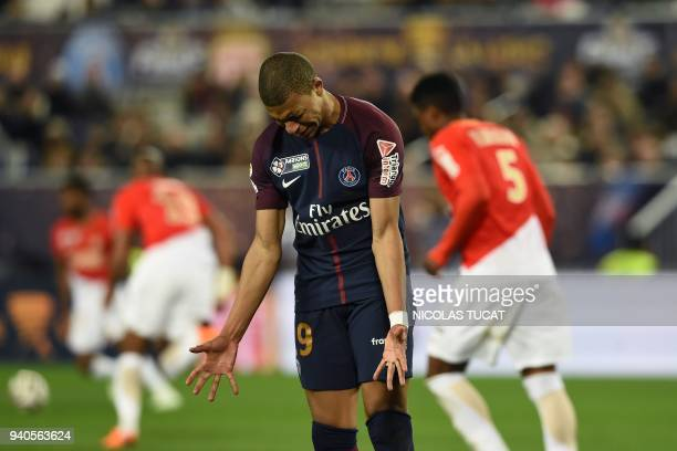 Paris SaintGermain's French forward Kylian Mbappe gestures during the French League Cup final football match between Monaco and Paris SaintGermain at...
