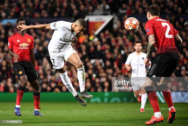 Paris SaintGermain's French forward Kylian Mbappe heads the ball during the first leg of the UEFA Champions League round of 16 football match between...