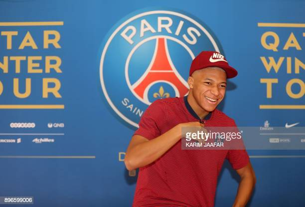 Paris SaintGermain's French forward Kylian Mbappe holds a press conference in Doha on December 21 during a winter training camp in Qatar / AFP PHOTO...